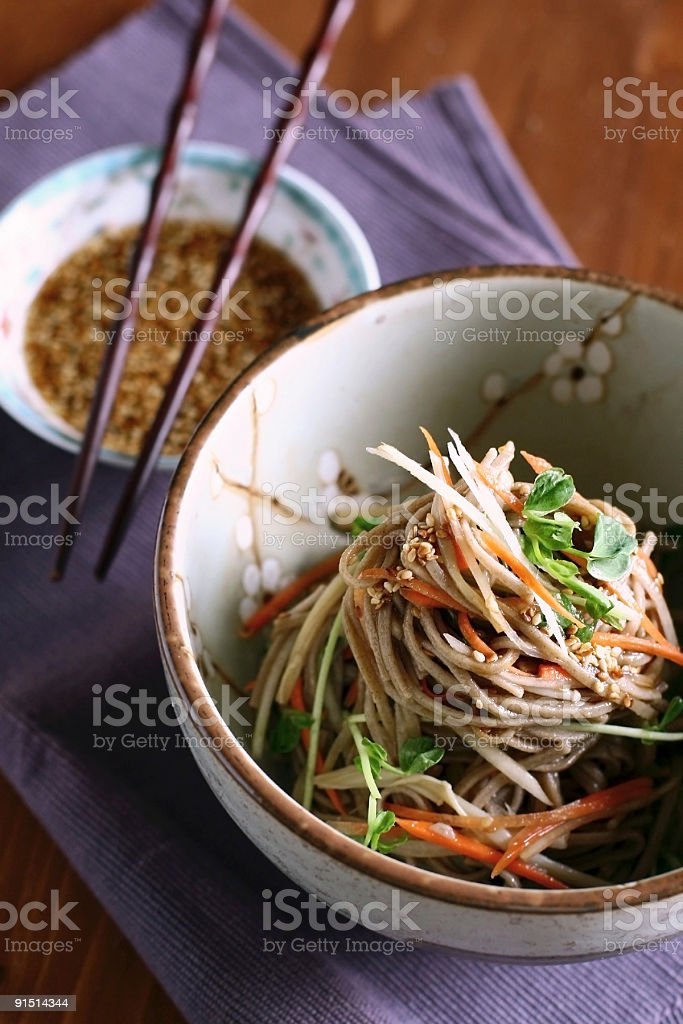 soba noodle salad with vegetable stock photo