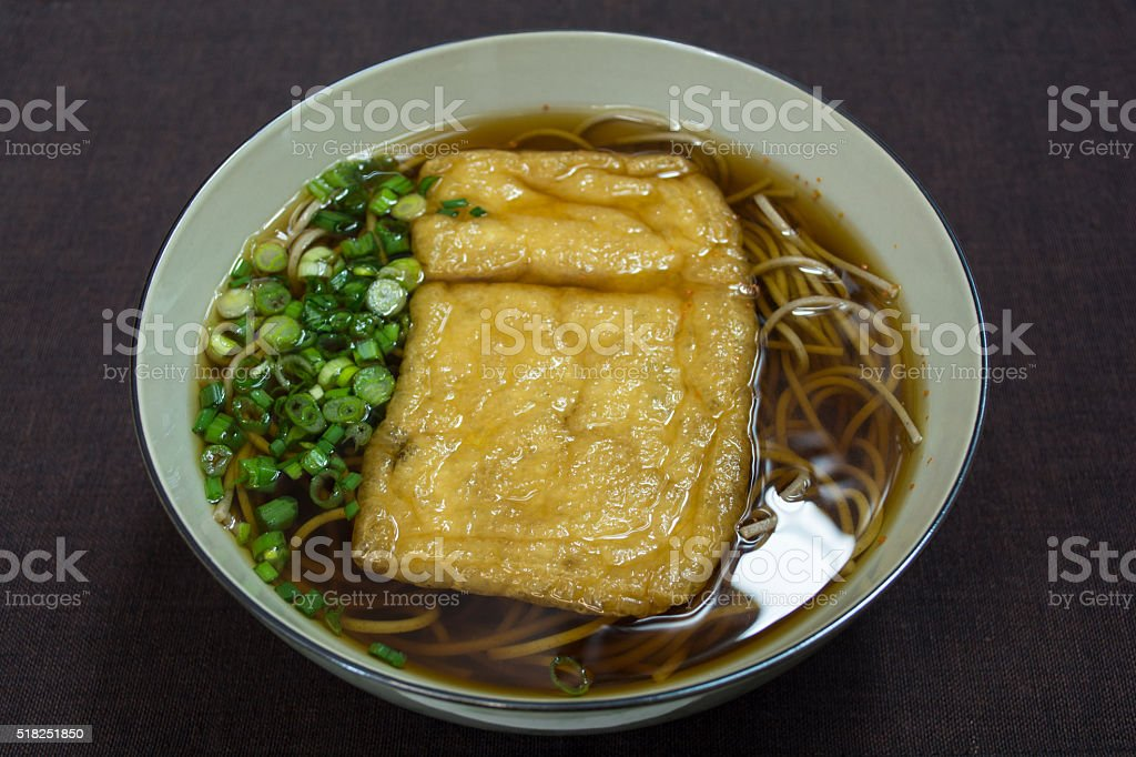Soba noodle with fried bean curd stock photo