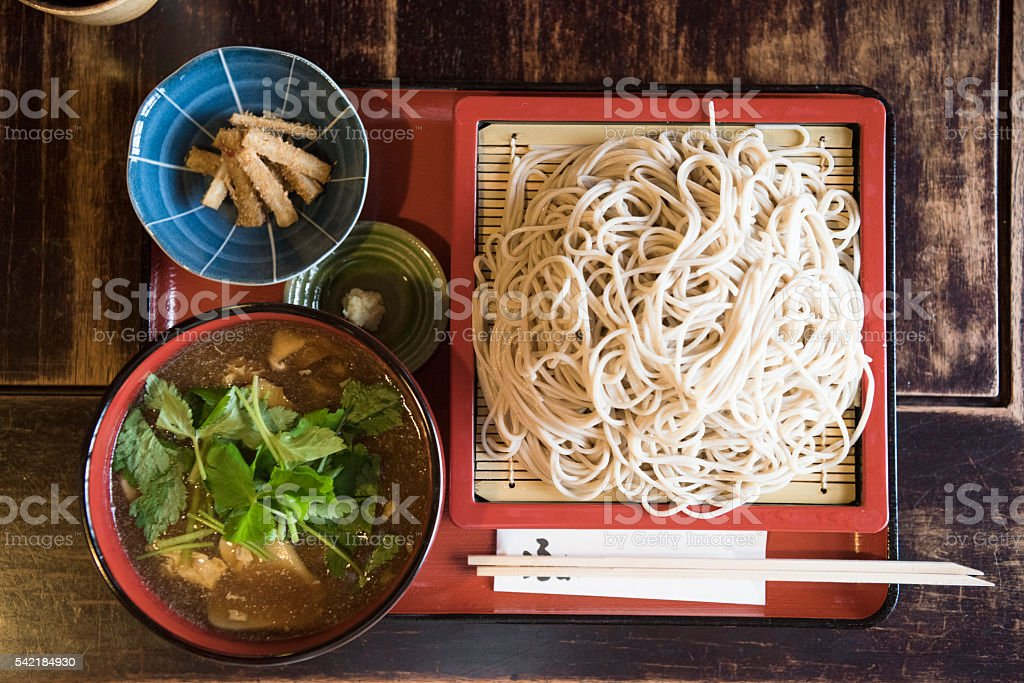Soba noodles in square dish with side dishes stock photo