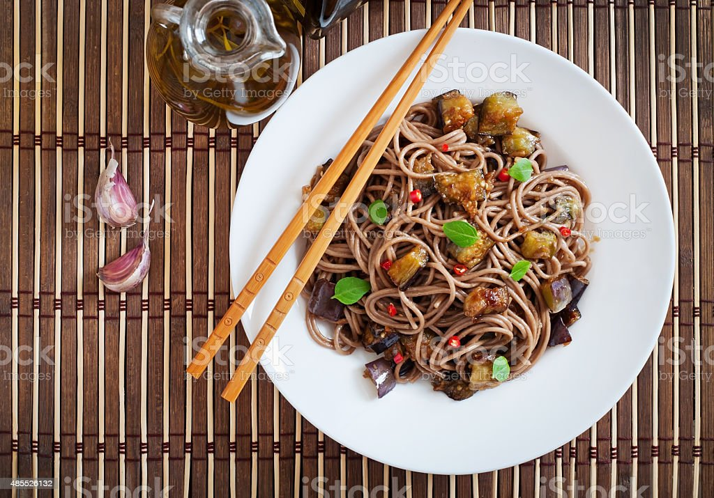 Soba noodles with eggplant in sweet and sour sauce stock photo