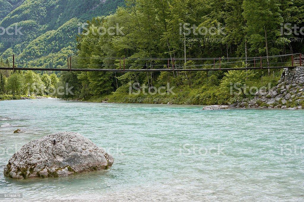 Soca river Slovenia with plank bridge stock photo