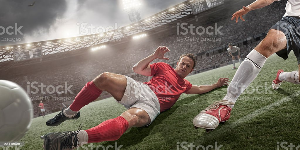 Soccer Action Sliding Tackle stock photo