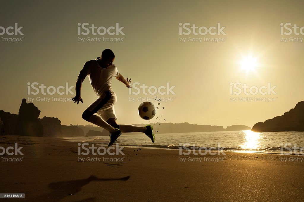 Soccer at the beach stock photo
