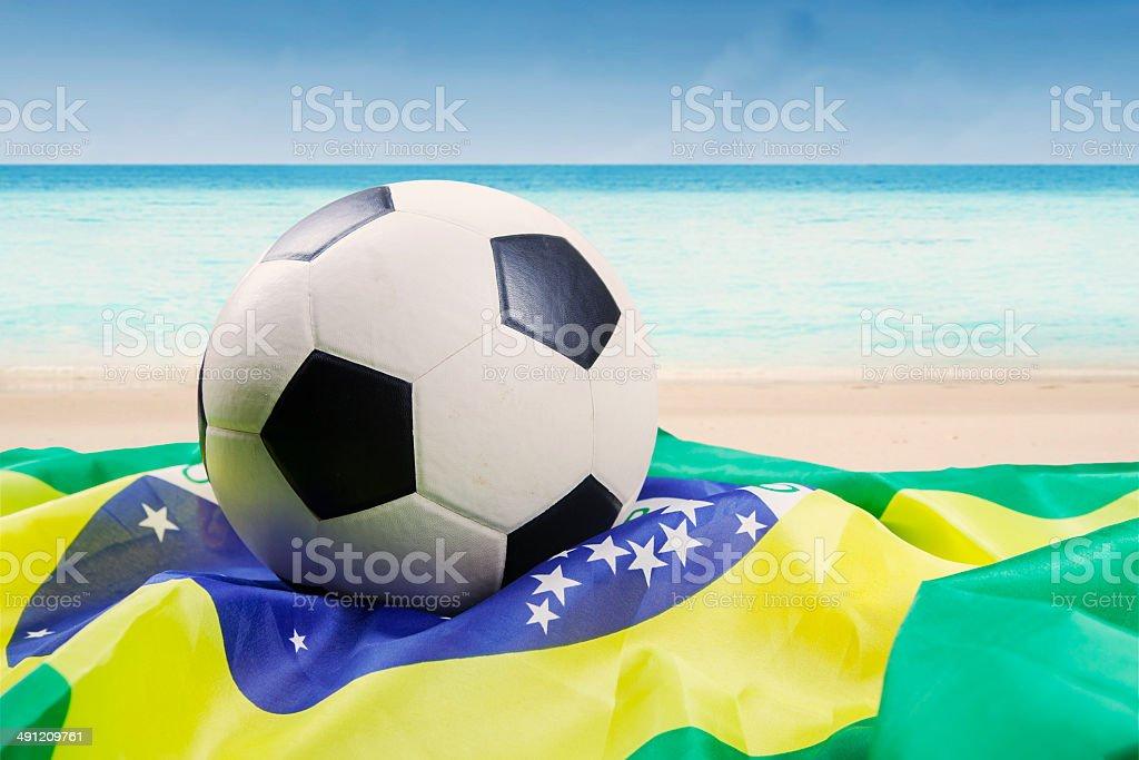 Soccer ball above brazilian flag royalty-free stock photo