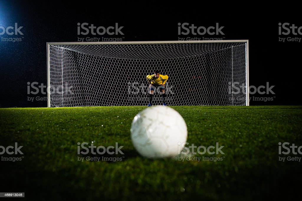 Soccer Ball Against A Goalie stock photo