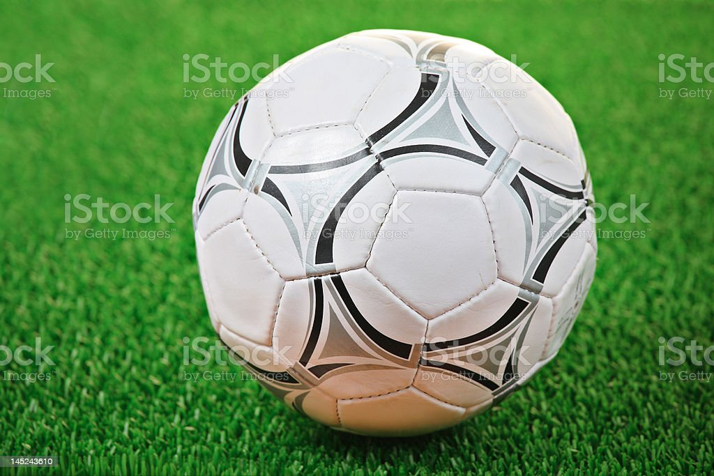 Soccer ball against grass background royalty-free stock photo
