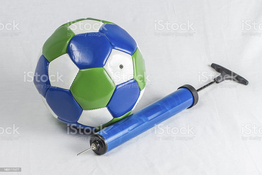 Soccer Ball and Air Pump stock photo