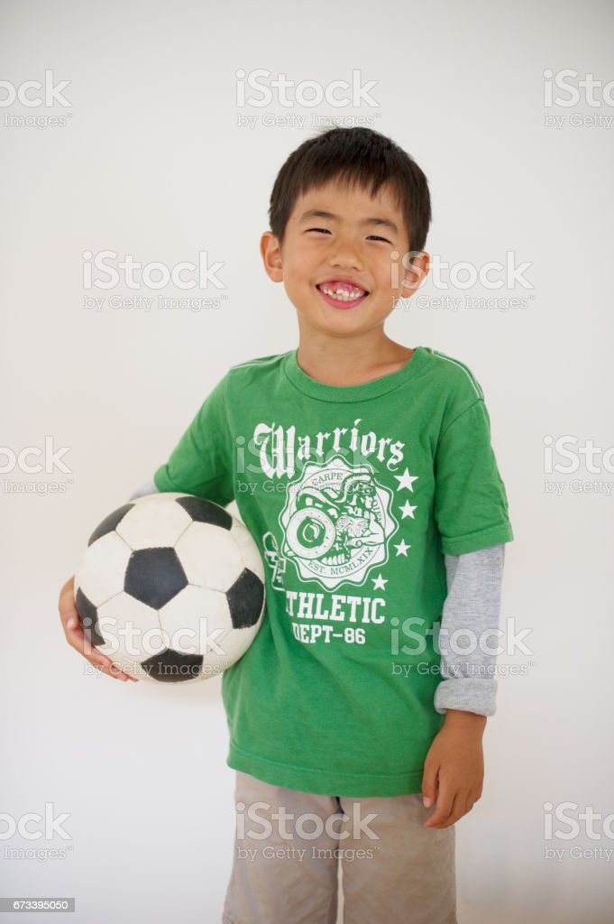 Soccer ball and boy stock photo