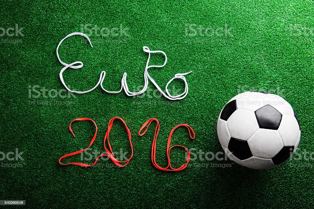 Soccer ball and Euro 2016 sign against artificial turf stock photo