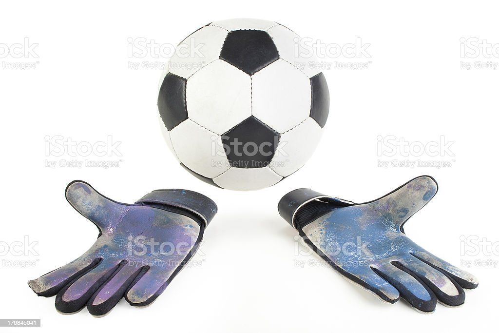 Soccer ball and goalkeeper gloves royalty-free stock photo