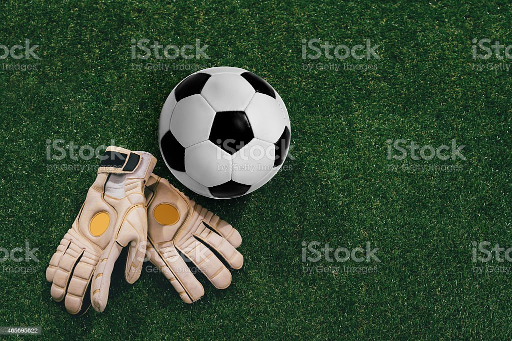 Soccer ball and goalkeeper gloves stock photo