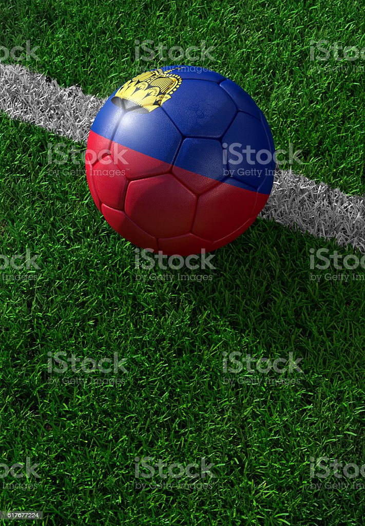 Soccer ball and national flag of Lichtenstein,  green grass stock photo