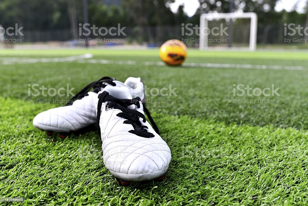 soccer ball and shoes royalty-free stock photo