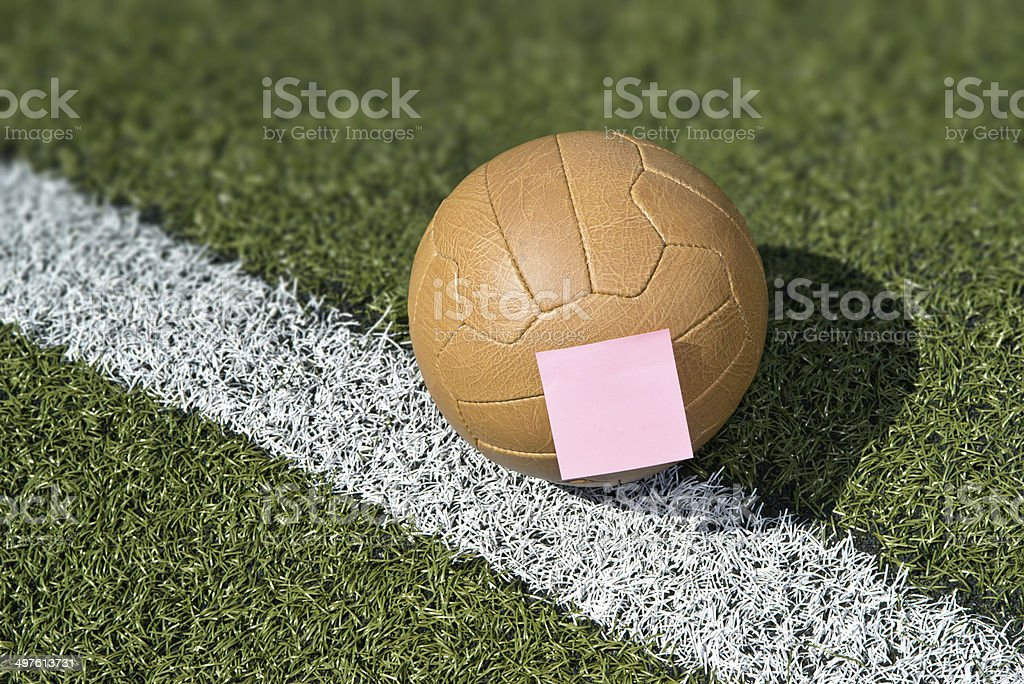 Soccer ball and sticky note stock photo