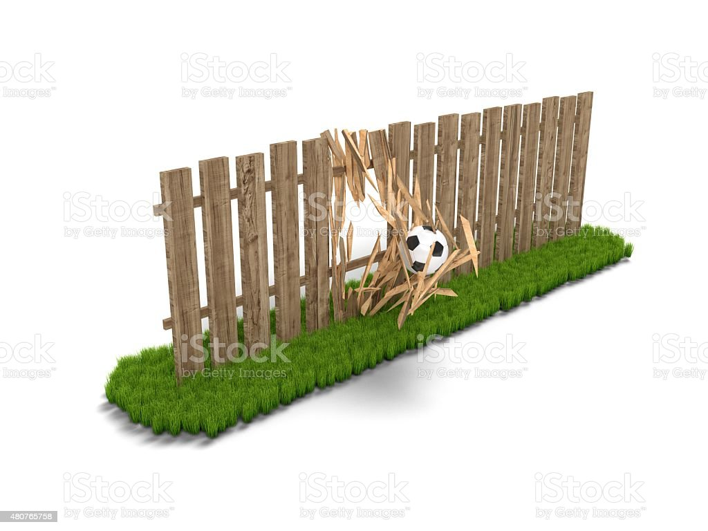 Soccer ball breaking the wooden fence stock photo