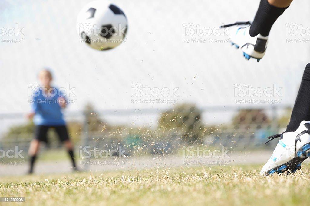 Soccer ball flying toward goal during free kick stock photo