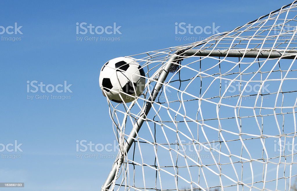 Soccer ball hits the net and makes a goal stock photo