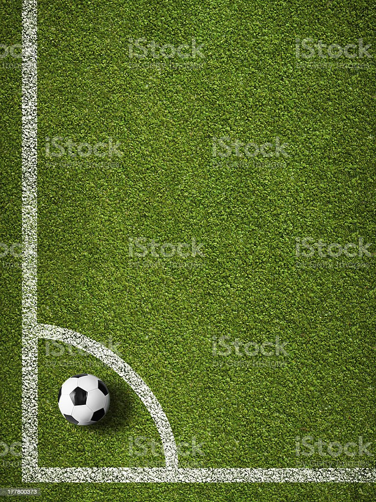 Soccer ball in corner kick position. Football field top view. stock photo