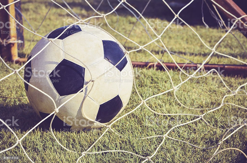 Soccer ball in goal, Close up image stock photo
