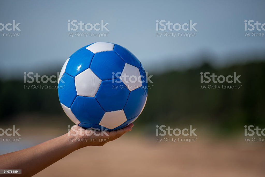 Soccer Ball in Hand stock photo