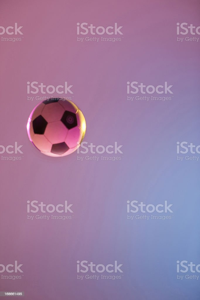 Soccer ball in midair royalty-free stock photo