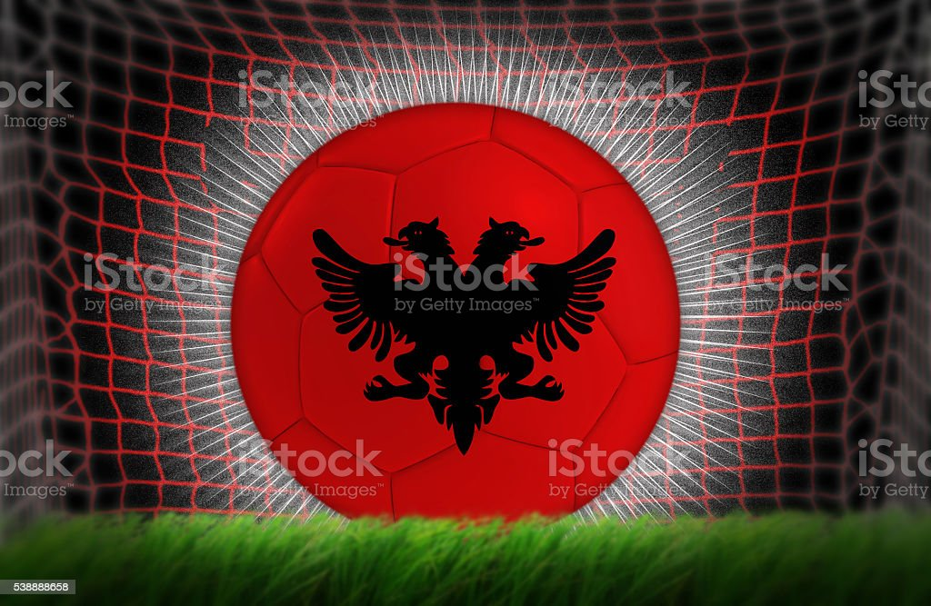 Soccer ball in net with Albania flag stock photo