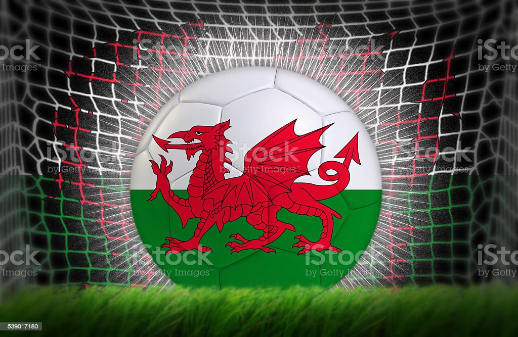 Soccer ball in net with Welsh flag stock photo