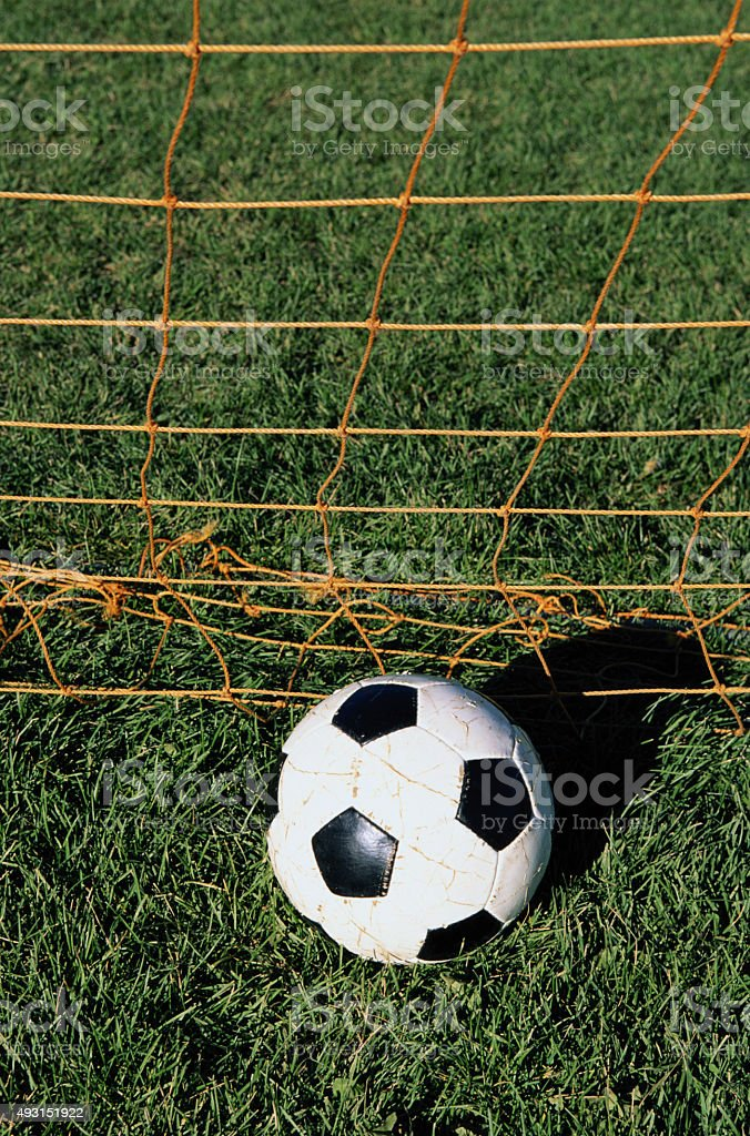 Soccer ball in nets stock photo
