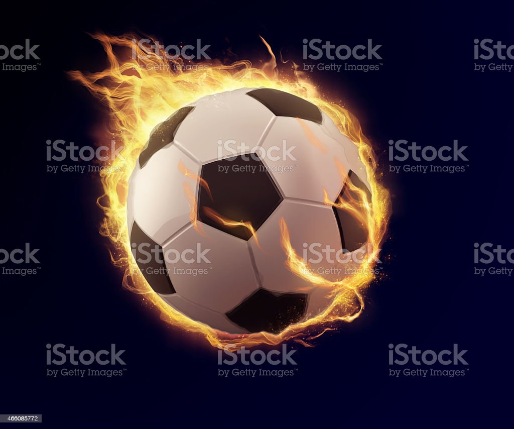 soccer ball in orange flame stock photo