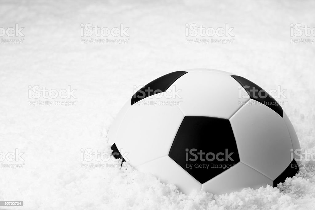 Soccer ball in snow royalty-free stock photo