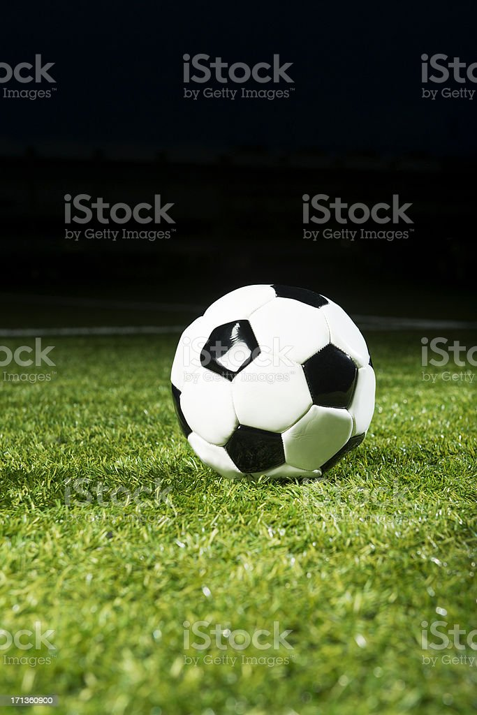 Soccer ball in stadium at night royalty-free stock photo