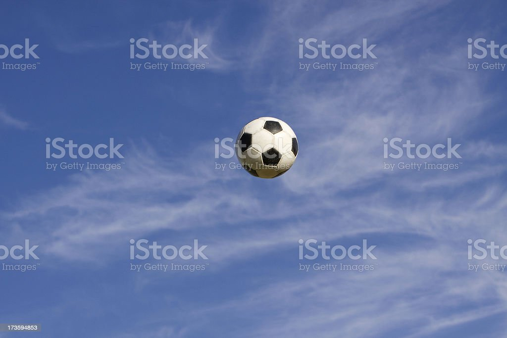 Soccer ball in the air stock photo