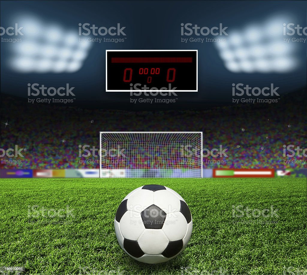 A soccer ball in the field ready to go in the goal stock photo