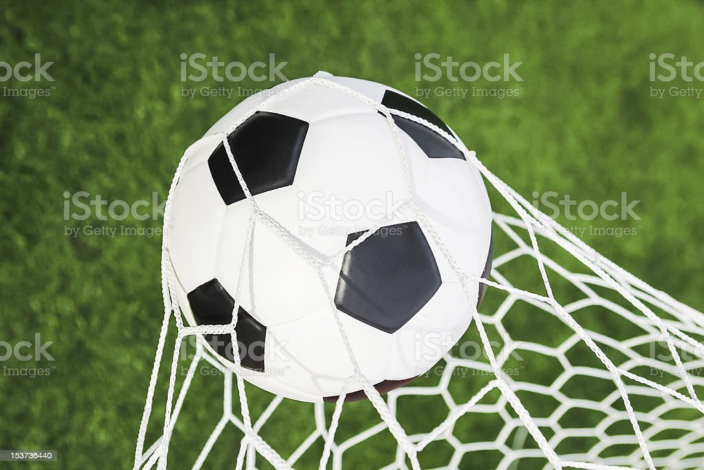 soccer ball in the goal net royalty-free stock photo