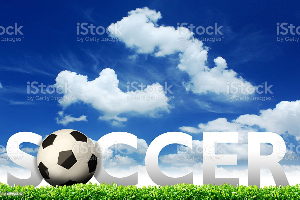 Soccer ball in the grass field with blue sky stock photo