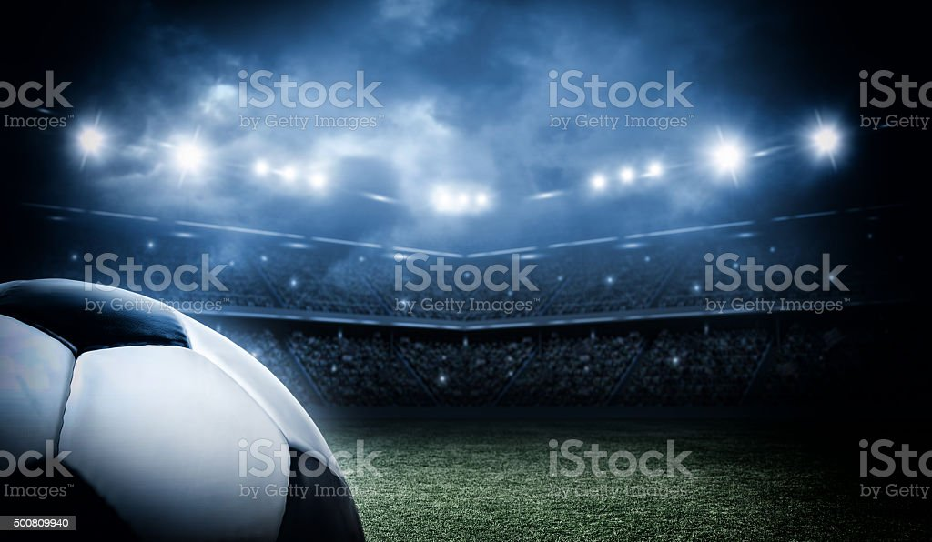 Soccer ball in the stadium stock photo