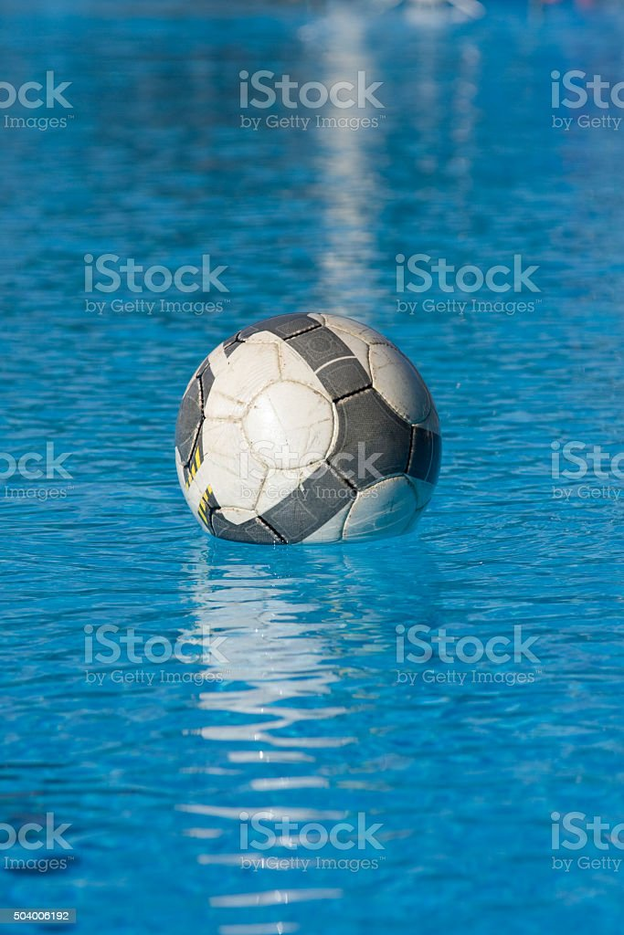Soccer ball in the water stock photo