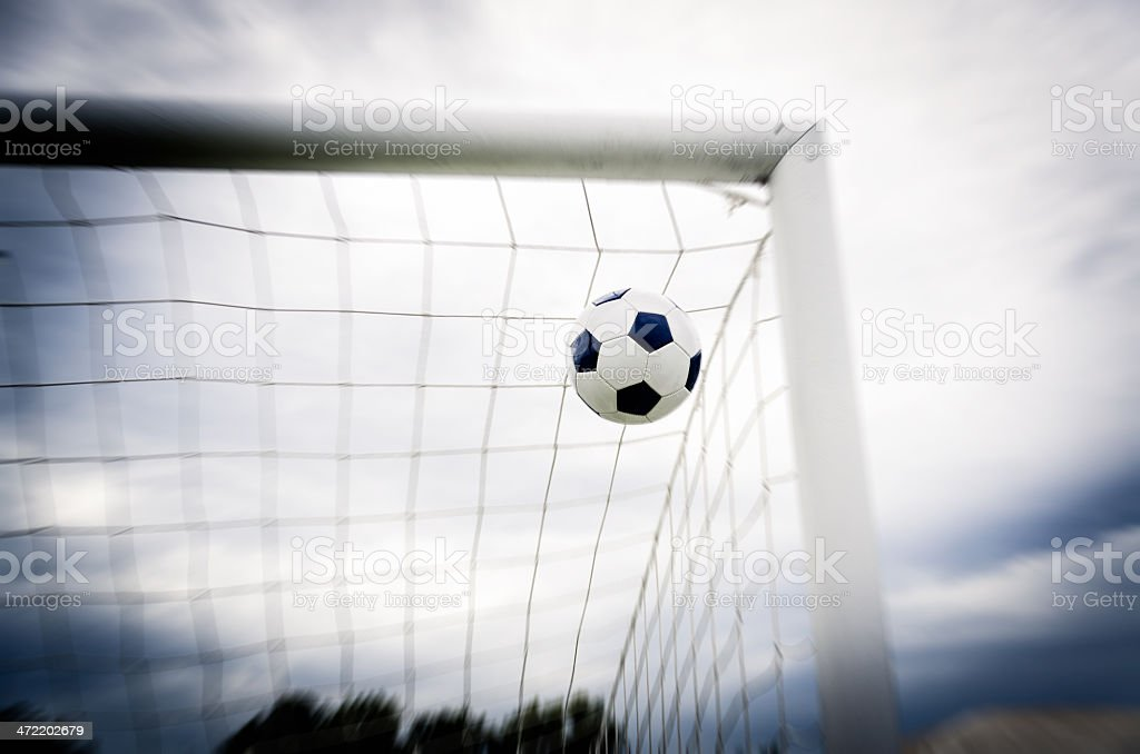Soccer ball into the net stock photo