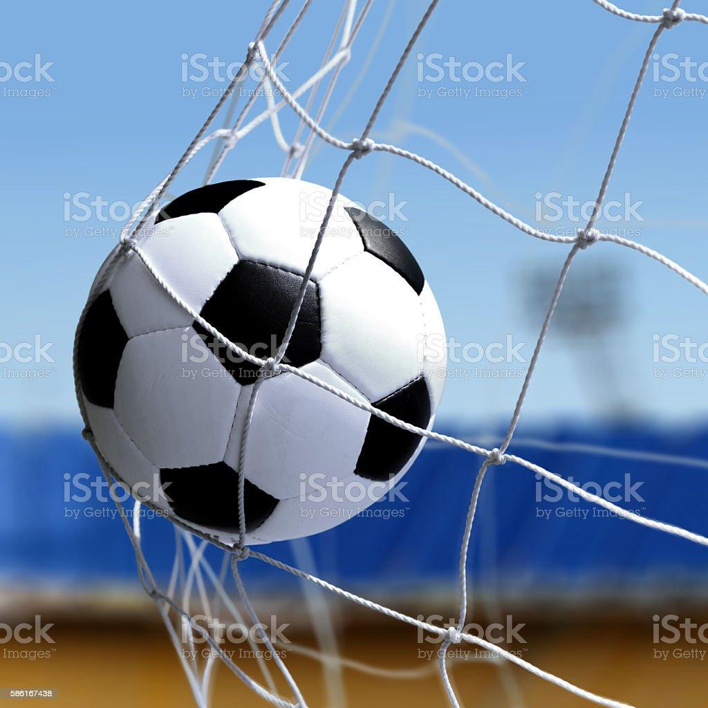 soccer ball is in goal net stock photo