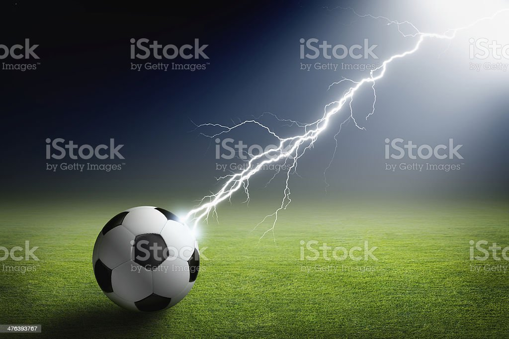Soccer ball, lightning, spotlight royalty-free stock photo