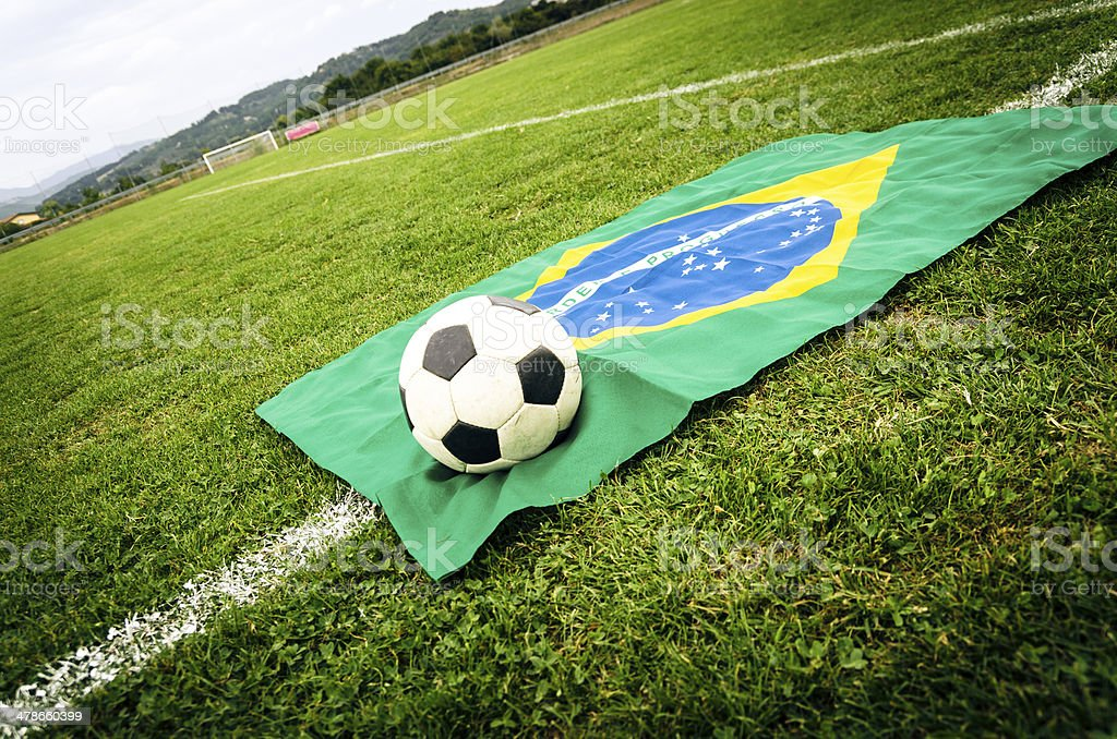 Soccer ball on a Brazilian flag royalty-free stock photo