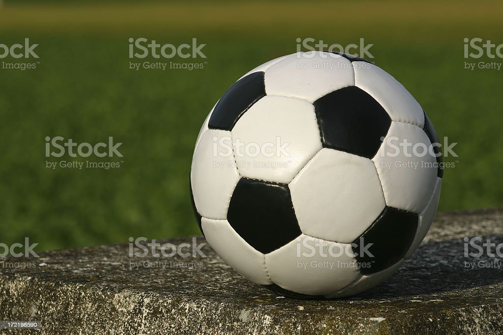 Soccer Ball on a concrete slab royalty-free stock photo