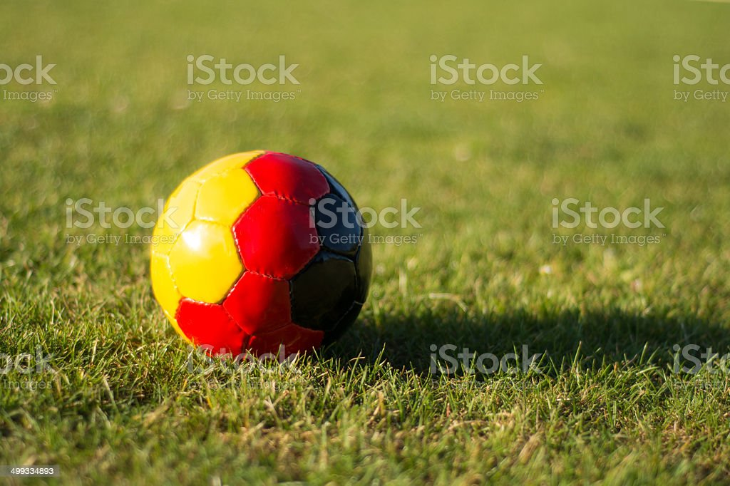 Soccer ball on a grass field  -Symbol of german flag stock photo