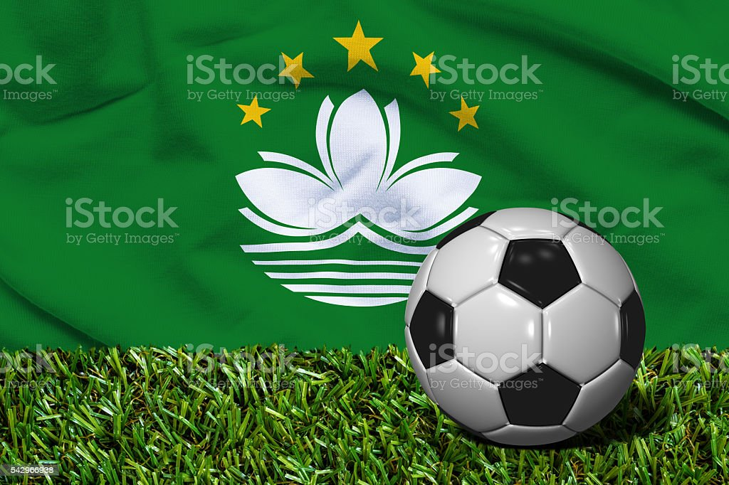 Soccer Ball on Grass with Macau Flag Background, 3D Rendering stock photo