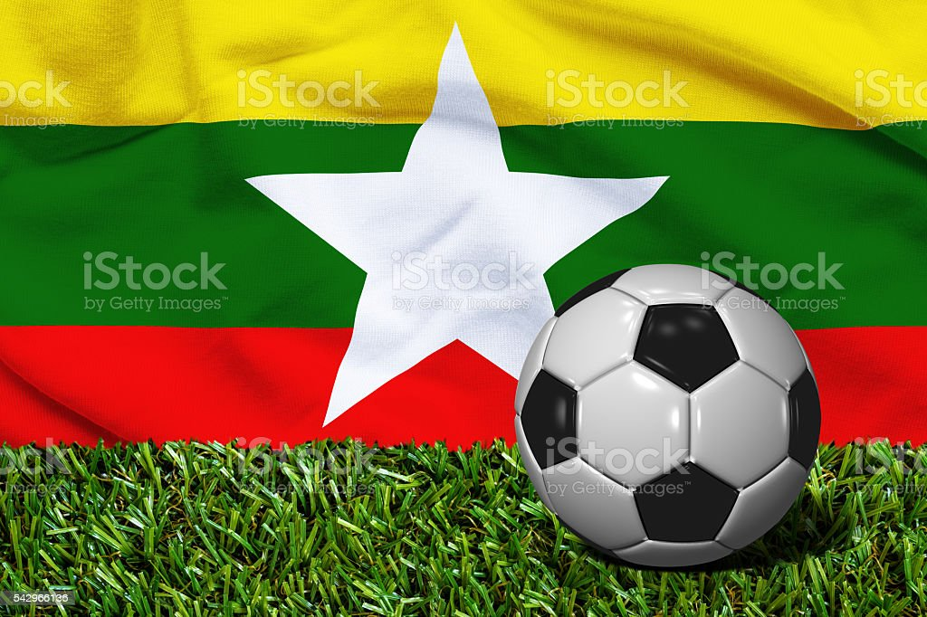 Soccer Ball on Grass with Myanmar Flag Background, 3D Rendering stock photo