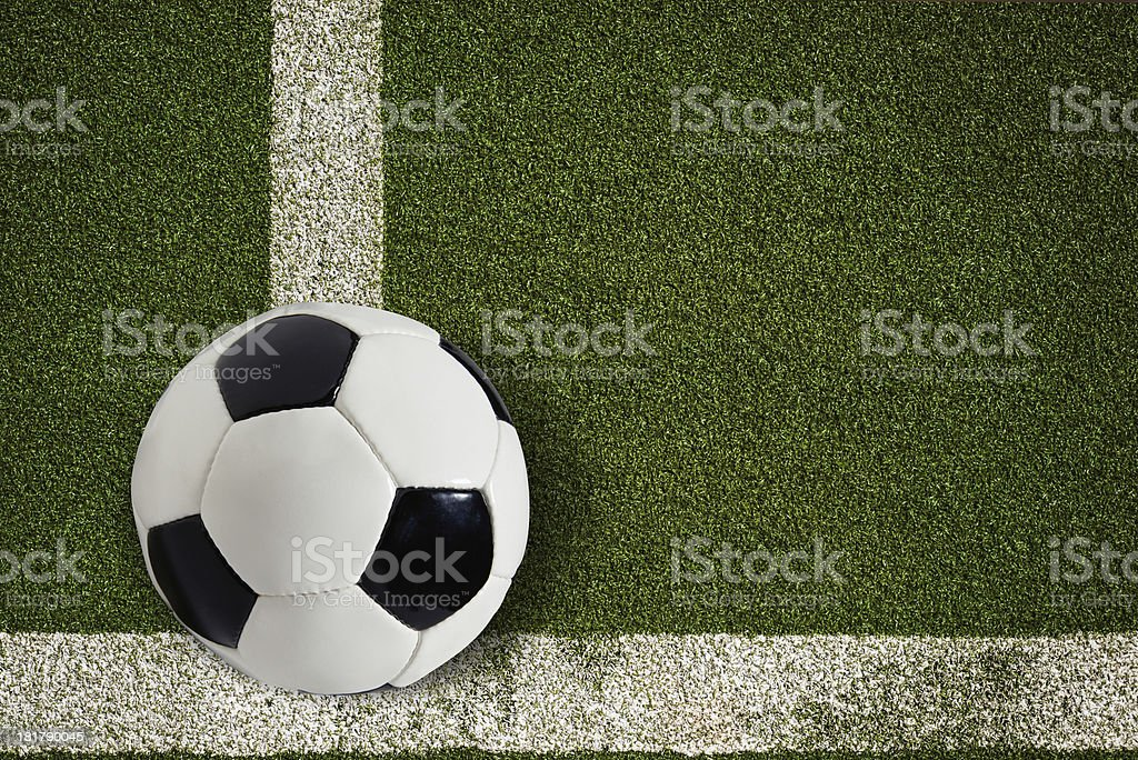 Soccer ball on green field royalty-free stock photo