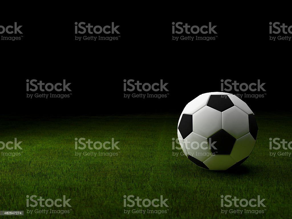 Soccer ball on green grass background stock photo
