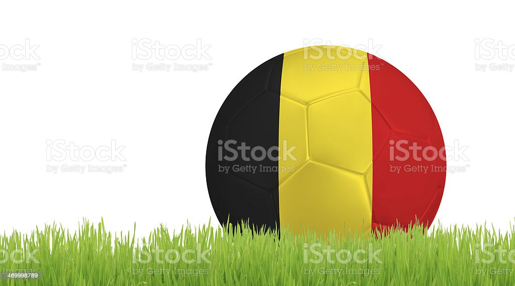 Soccer ball on green grass with colors of Belgian flag royalty-free stock photo