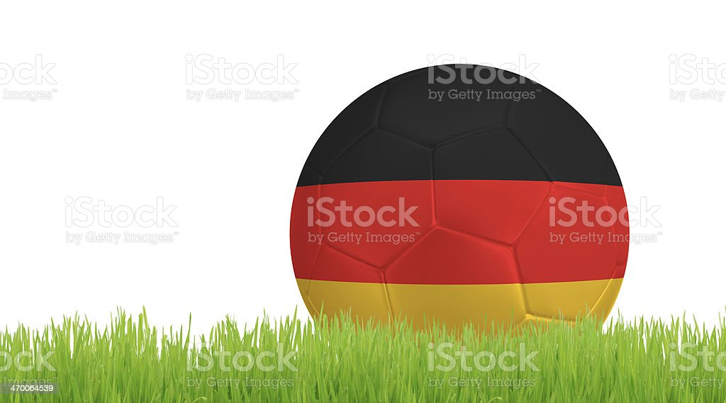 Soccer ball on green grass with colors of German flag royalty-free stock photo