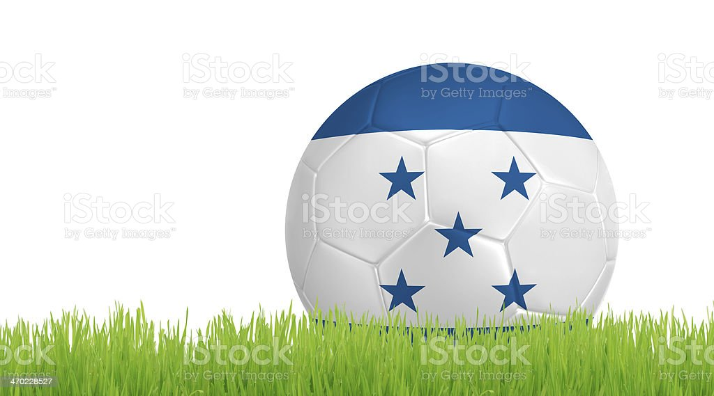 Soccer ball on green grass with colors of Honduras flag stock photo
